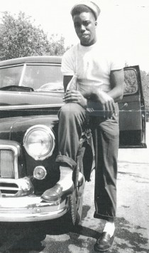 Post war, Mr. Hope is leaning on a car he rented to drive to Montreal, Quebec.