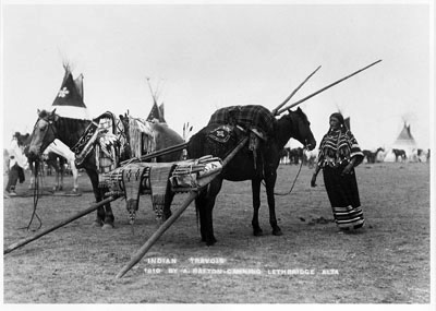 Kainai (Blood Tribe) with travois c. 1910