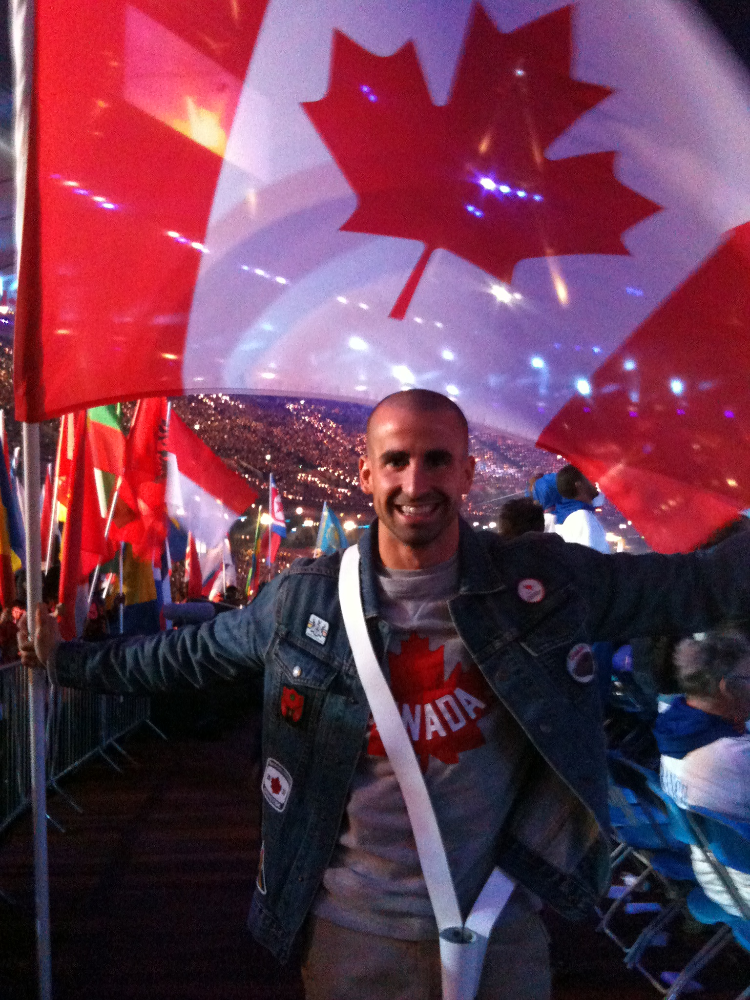 Benoit Huot carrying the flag at the closing ceremony of the 2012 Paralympic Games.
