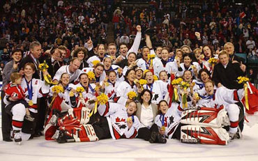 Women's Olympic Hockey Team  celebrating their gold medal