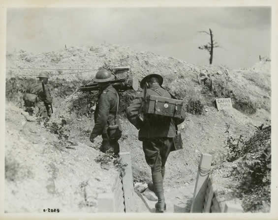 Members of the Canadian War Records Office camera team carrying their equipment.