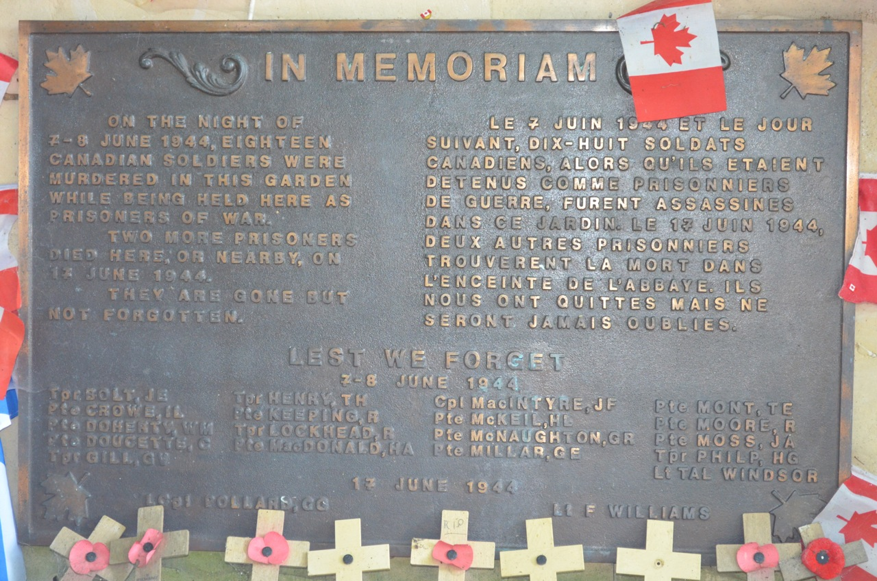 A plaque in the garden at the Abbaye Ardenne, commemorating the massacre of Canadian prisoners in early June, 1944.