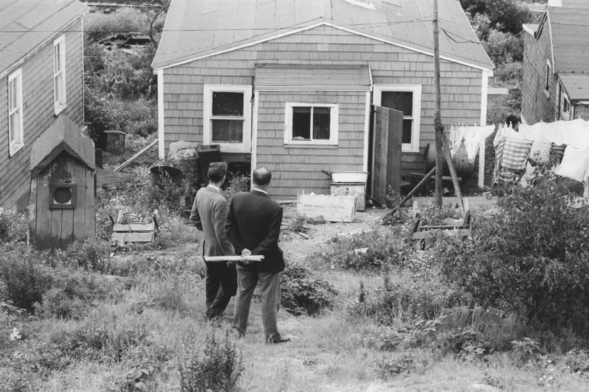 Halifax officials in Africville, prior to demolition of the community, 1965.