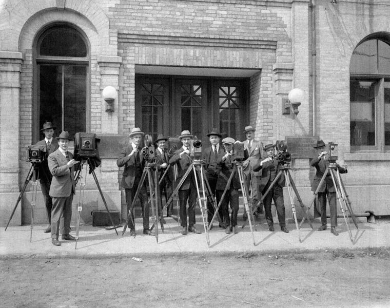 Cameramen outside the Canadian Government Motion Picture Bureau