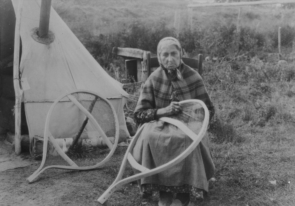 Indigenous woman making snowshoes (c. 1928)
