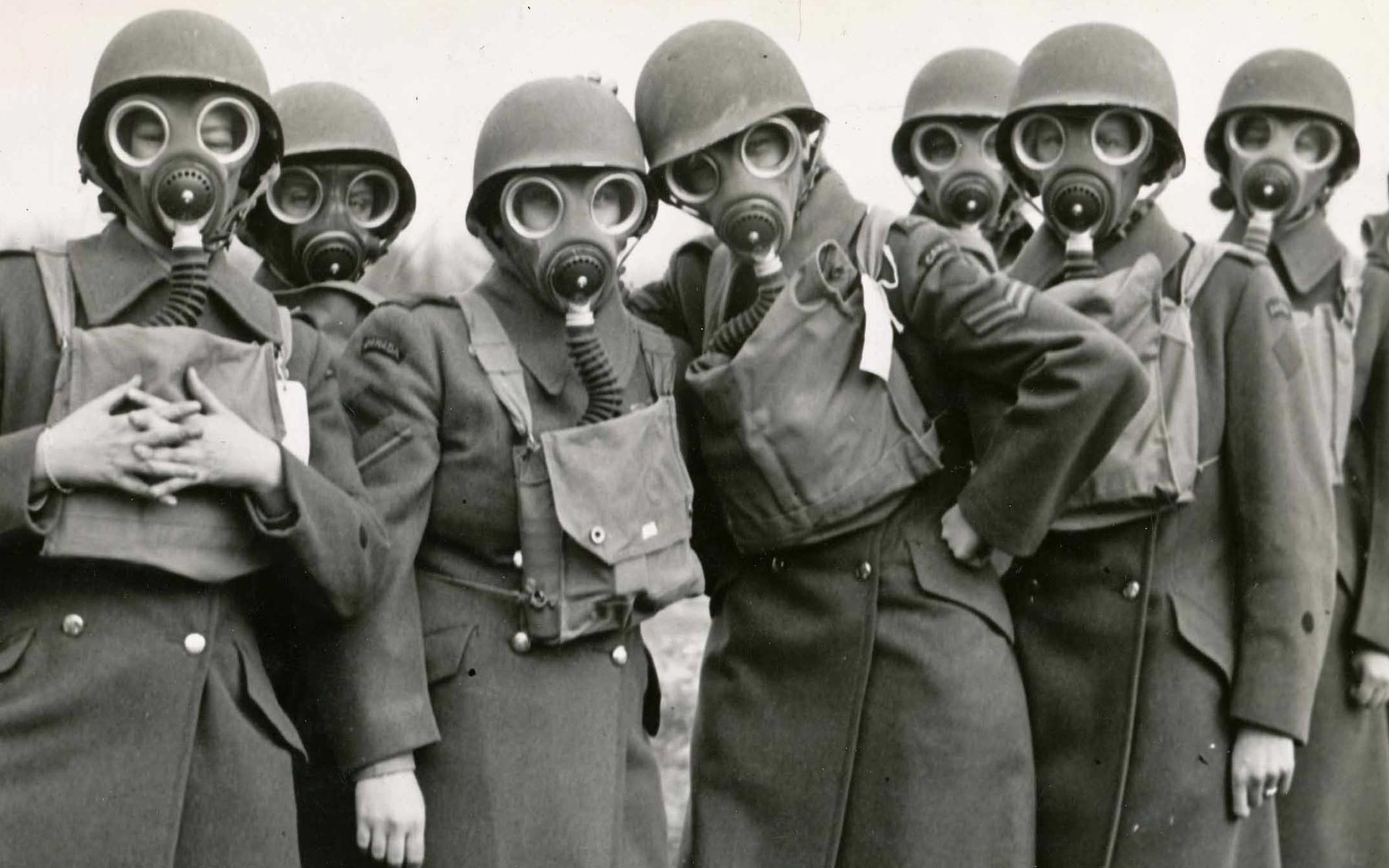Aileen Hanger with additional members of CWAC, on a break during gas mask training.