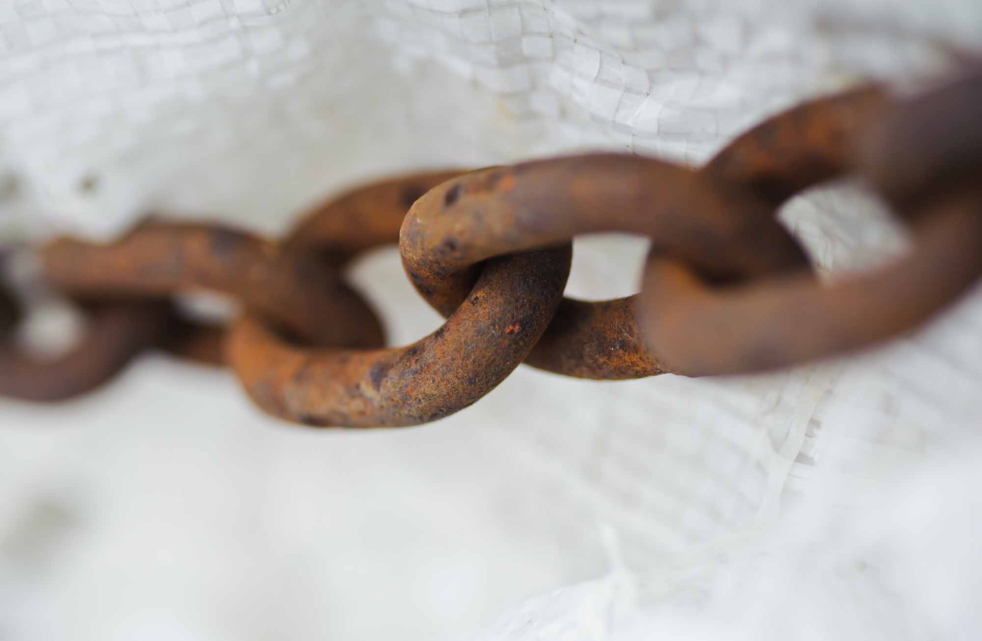 \u00a0Abstract metal thick chain. Old and rusty. slavery metaphor