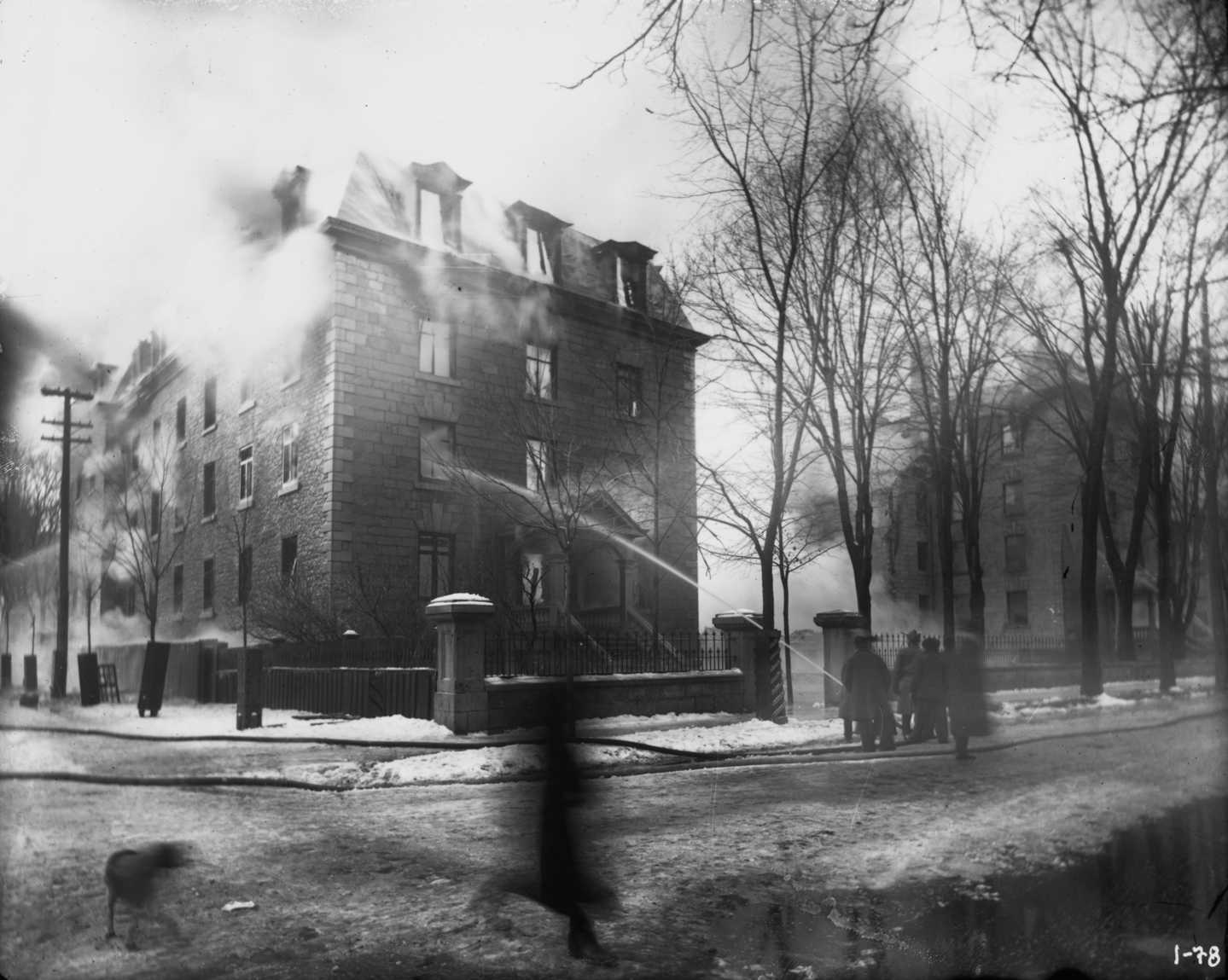 Photograph of the university's main building during the 1903 fire incident