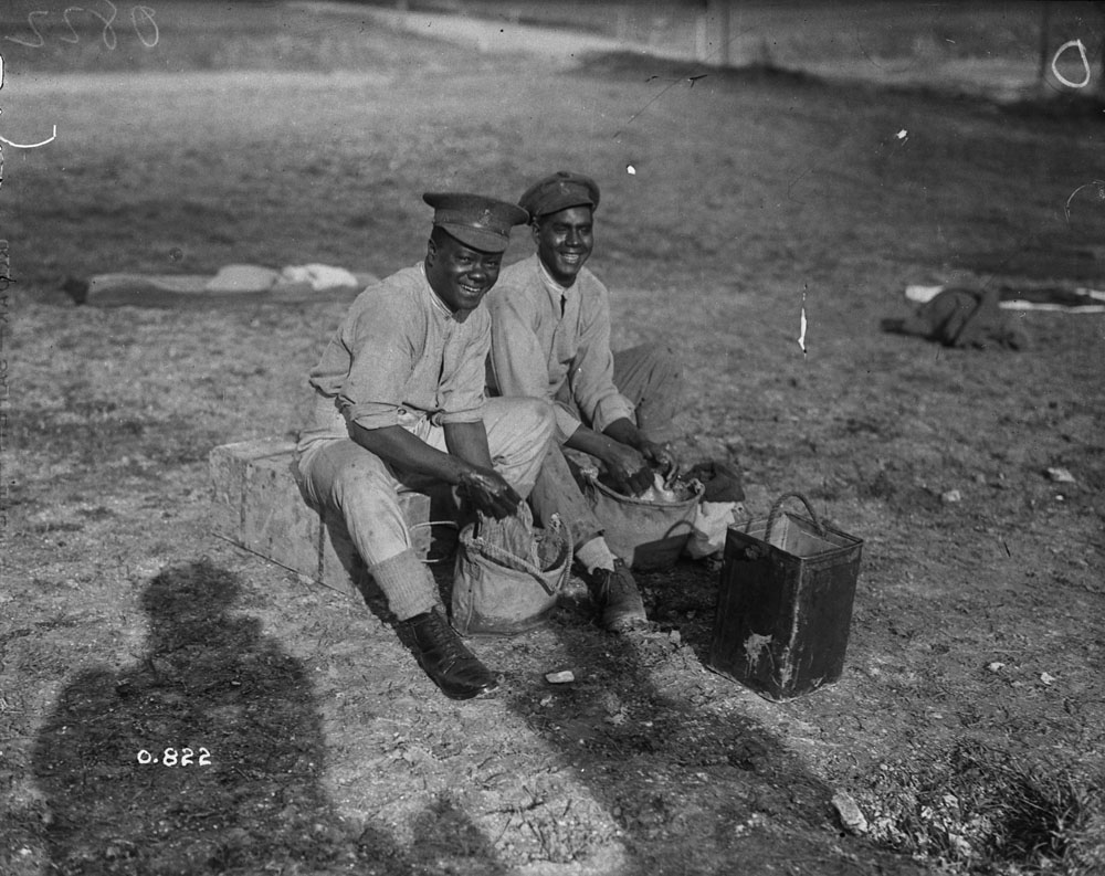 Two Black soldiers washing their clothing