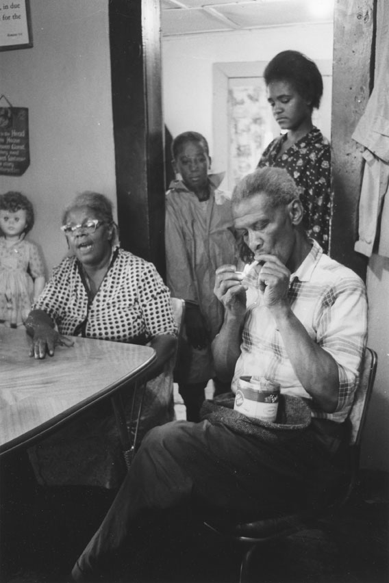Residents of Africville around a kitchen table, 1965.
