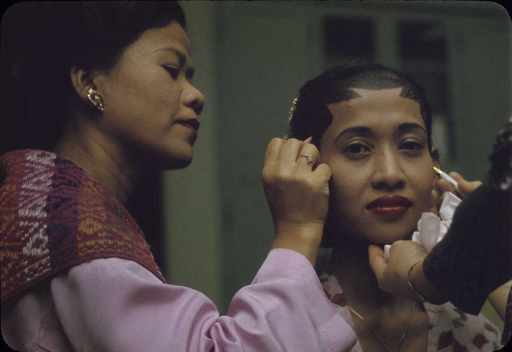 """Asian Evening"" at Friendship House, Ottawa - Indonesian woman having makeup applied for a performance (1963)"