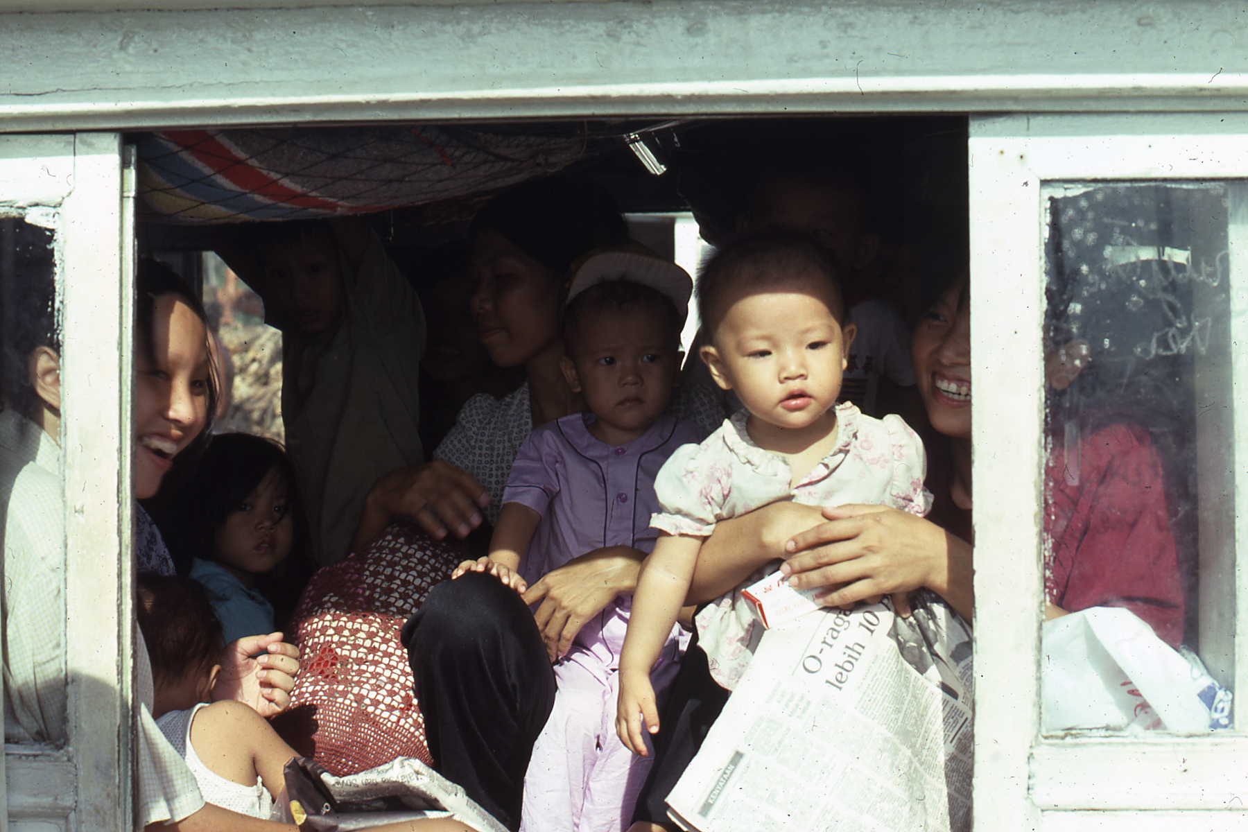 Baby and family leaving Pulau Bidong camp by boat, October 1979