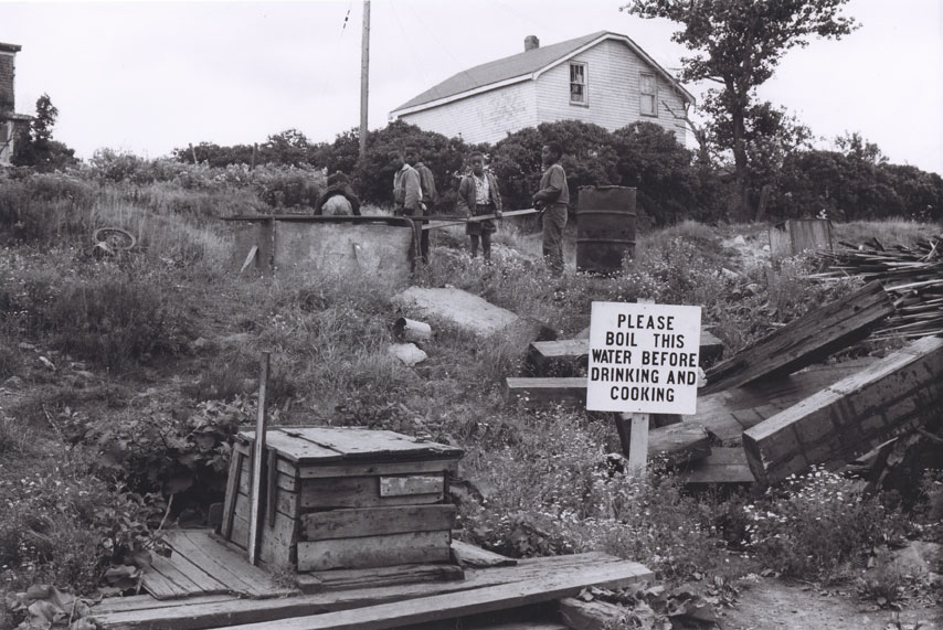 Children playing around a water well in Africville, 1965.
