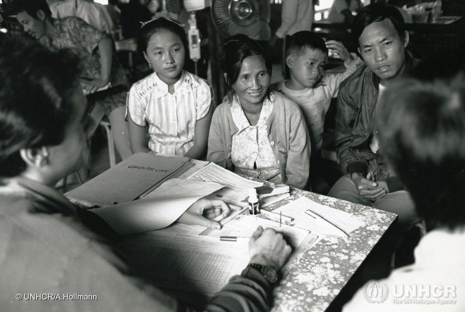 Laotian Hilltribe refugees receiving resettlement counselling in Chiang Kham camp, Thailand, 1988