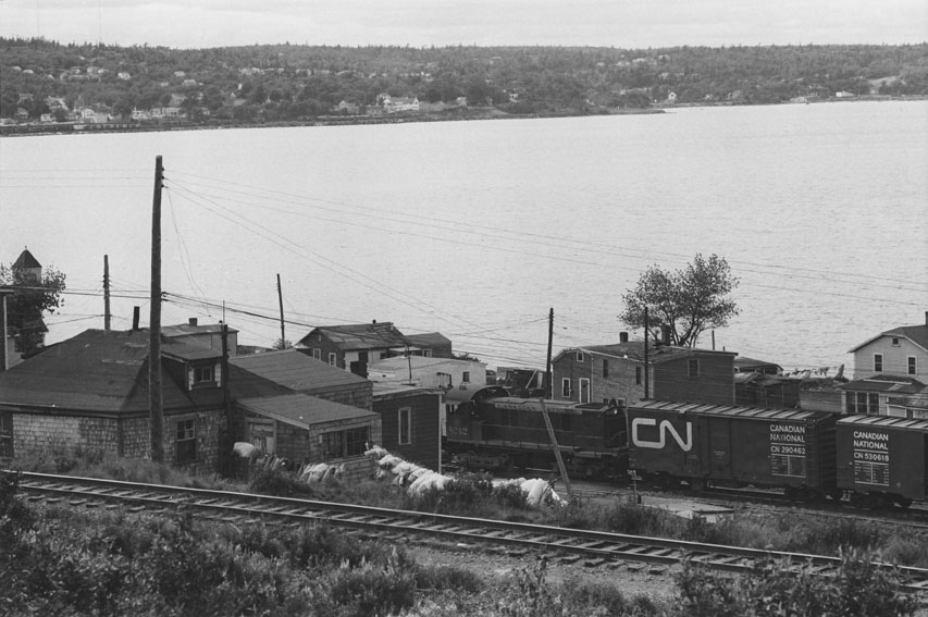Canadian National freight train passing through Africville, 1965.