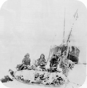 Netsilingmiut live on the Arctic coast of Canada west of Hudson Bay. They were photographed here visiting Amundsen's expedition in 1903.