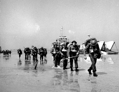 Canadian soldiers landing on Juno Beach, Courseulles-sur-Mer, France, June 6th, 1944.