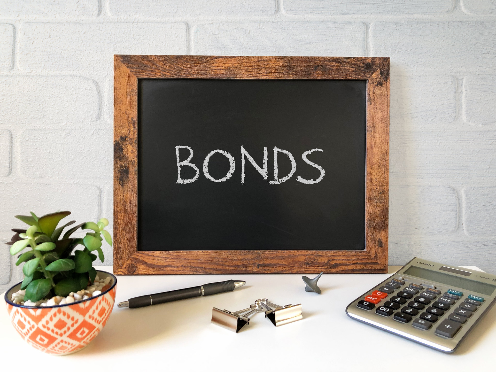 "Chalk board showing the word ""bonds"""