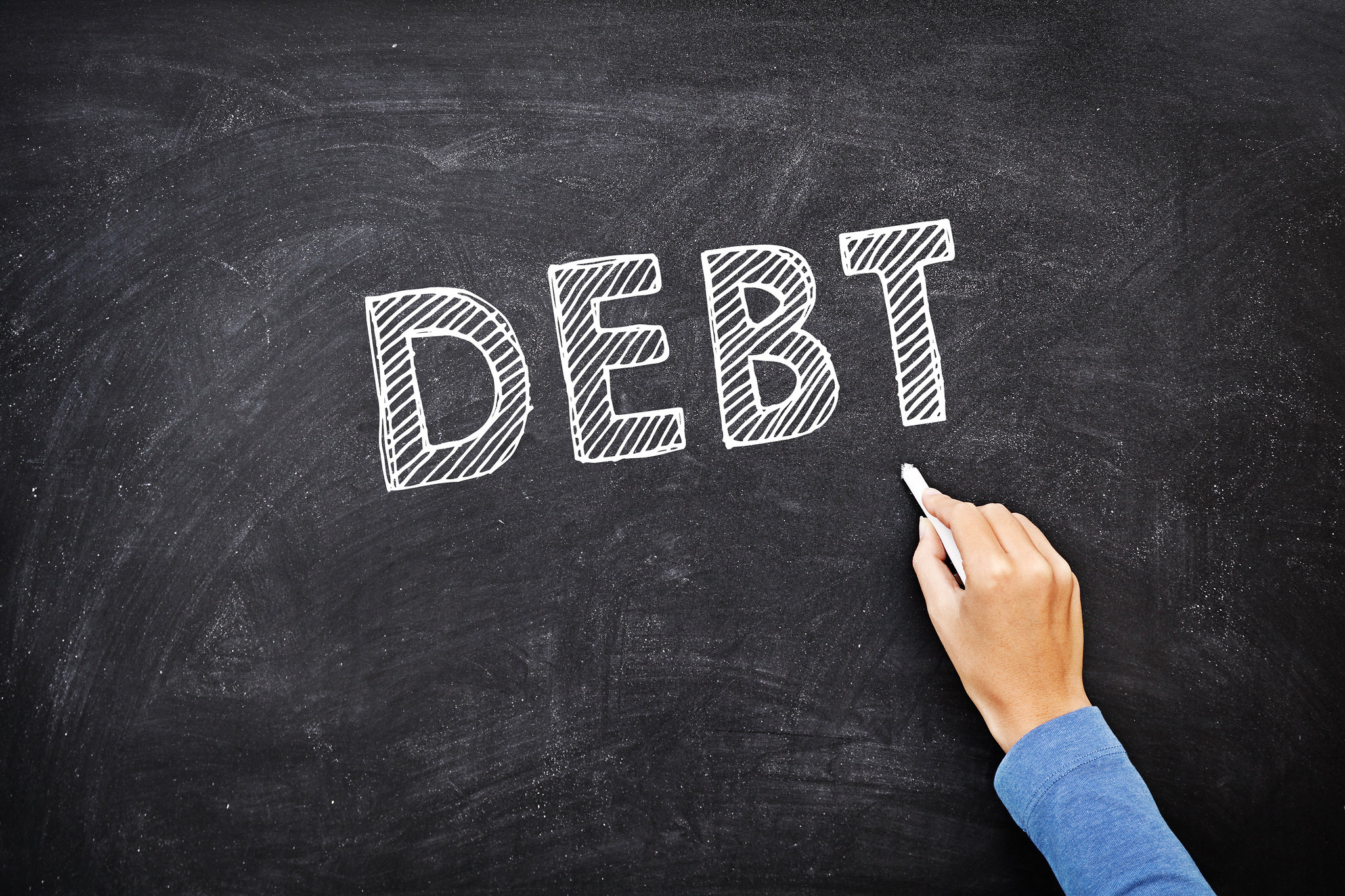 "Chalk board showing the word ""debt"""