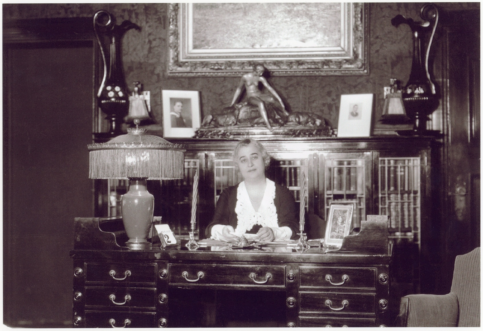 Photo of Lillian Freiman seated at her desk