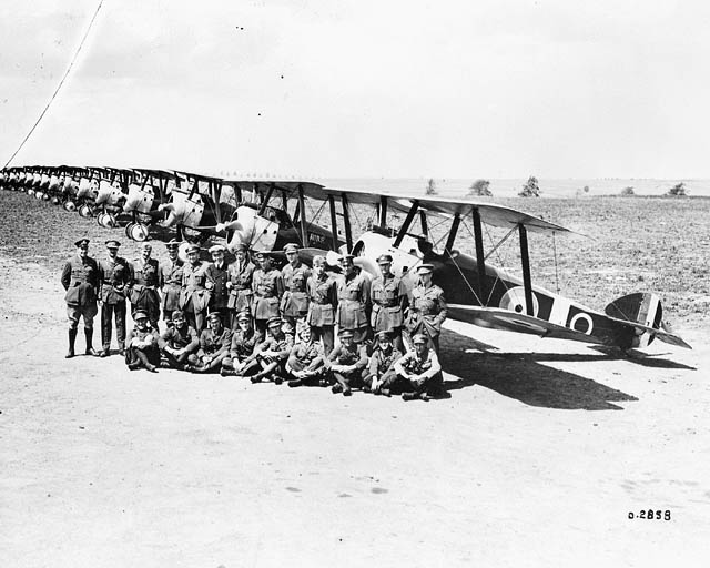 Raymond Collishaw and pilots with Sopwith F. 1 Camel aircraft of No. 203 Squadron, RAF on the occasion of an inspection by King George V, Izel-le-Hameau, France, 12 July 1918.