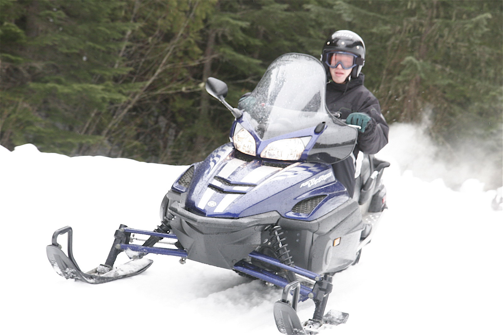 Photo of a person riding a snowmobile