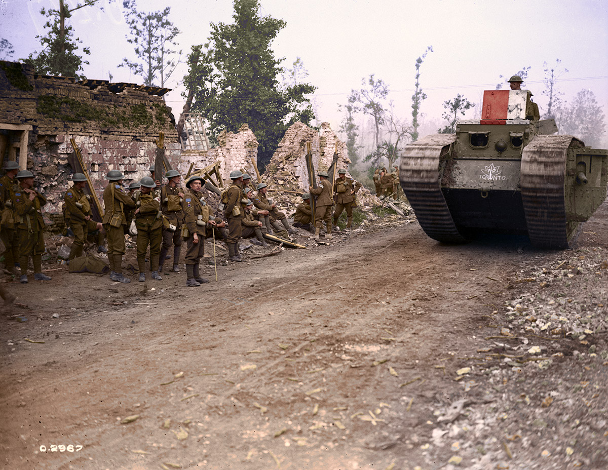 A Tank passing 8th Field Ambulance, Hangard. Battle of Amiens. August, 1918.