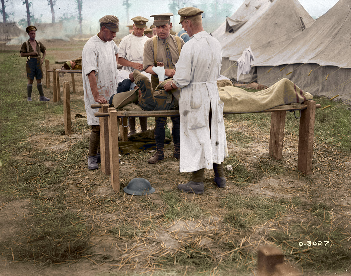 Major McGill and assistants, 5th Canadian Field Ambulance, dressing wounded outdoors, Battle of Amiens.