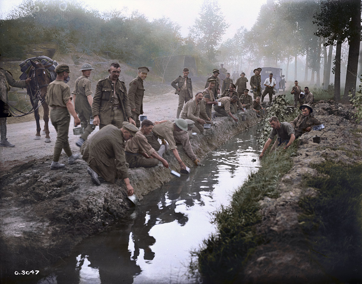 Canadians filling their water bottles, etc. Amiens, August 1918.