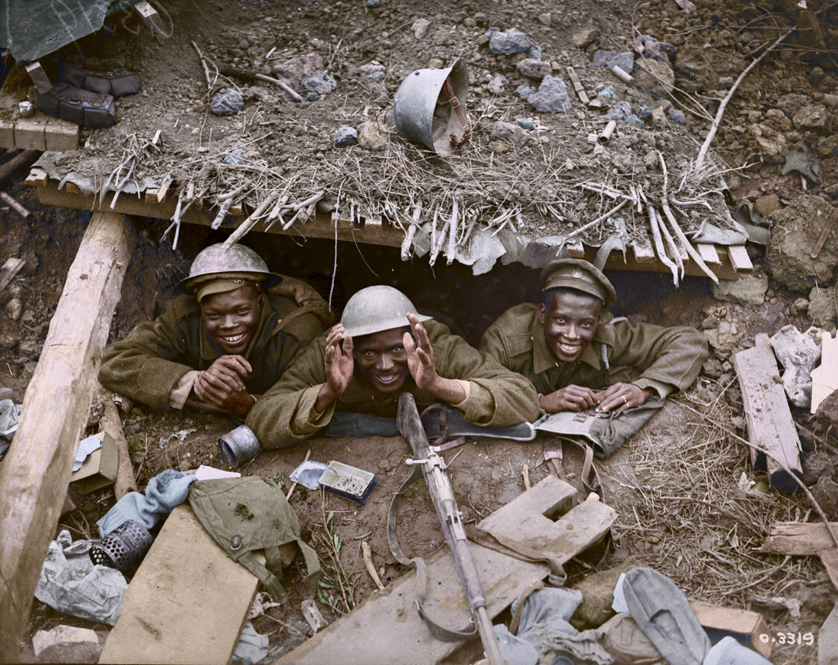 Three coloured soldiers in a German dug-out captured during the Canadian advance east of Arras.