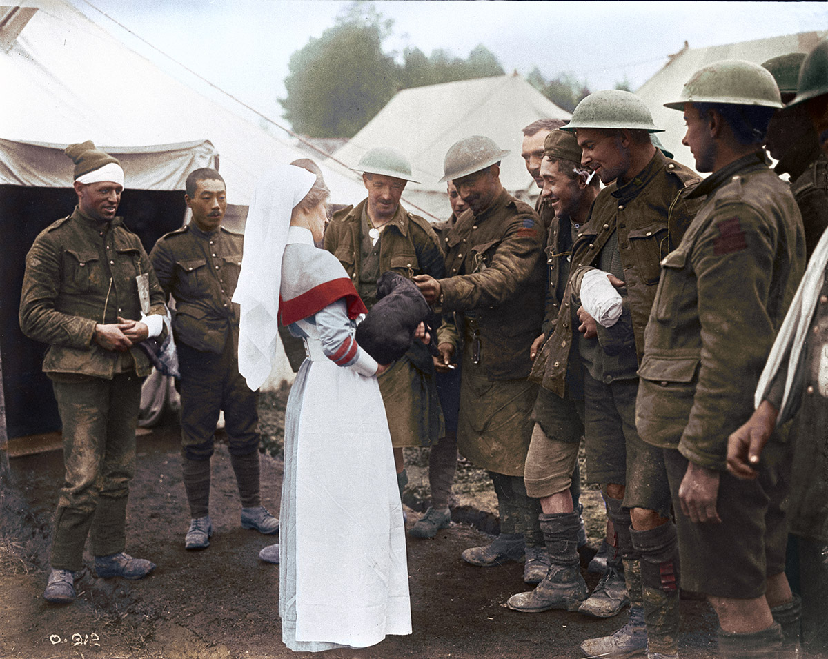 Casualty Clearing Station. Some wounded Canadians present a nurse with a dog brought out of the trenches with them. October 1916.
