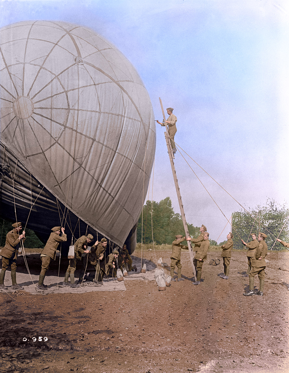 Repairing a kite balloon which was slightly damaged on a gusty day, Oct 1916.
